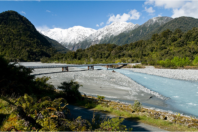 Continue your journey up the wild West Coast, stopping at Franz Josef to visit an ancient glacier.